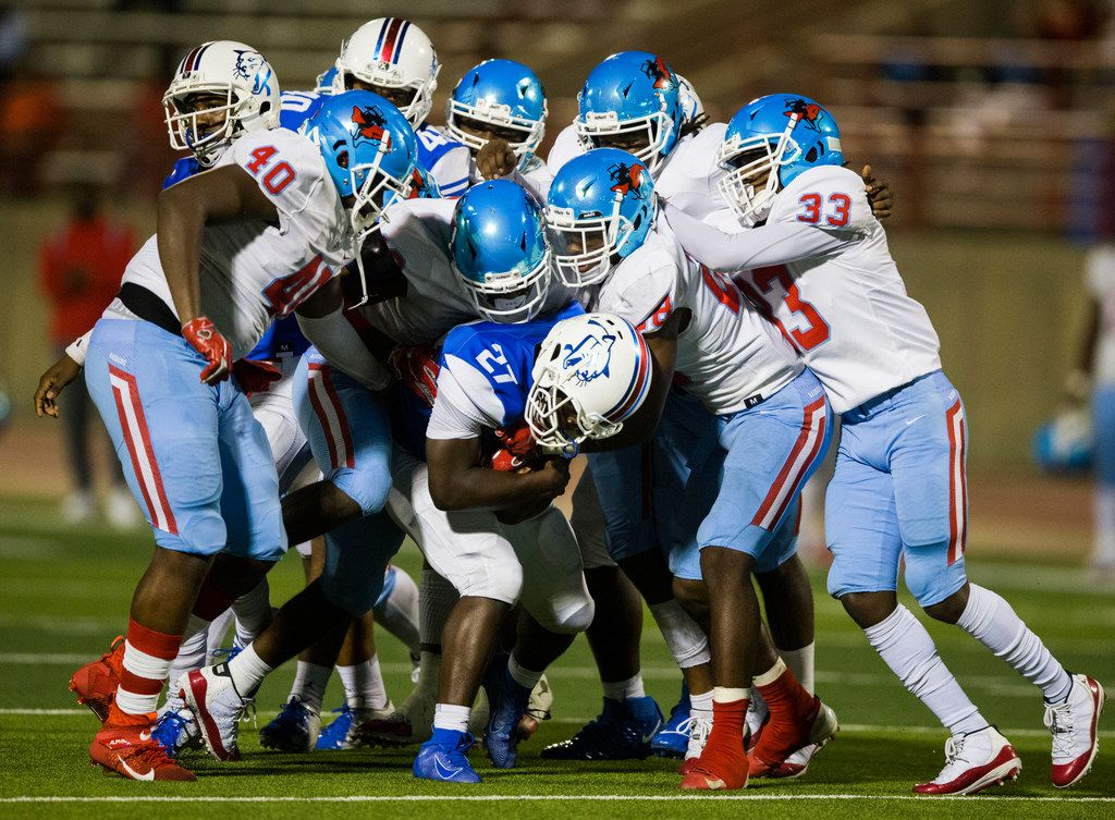 Duncanville running back Couvarris Butler (27) is tackled by the Skyline defensive line during the fourth quarter of a high school football game between Skyline and Duncanville on Friday, October 4, 2019 at Panther Stadium in Duncanville. (Ashley Landis/The Dallas Morning News)