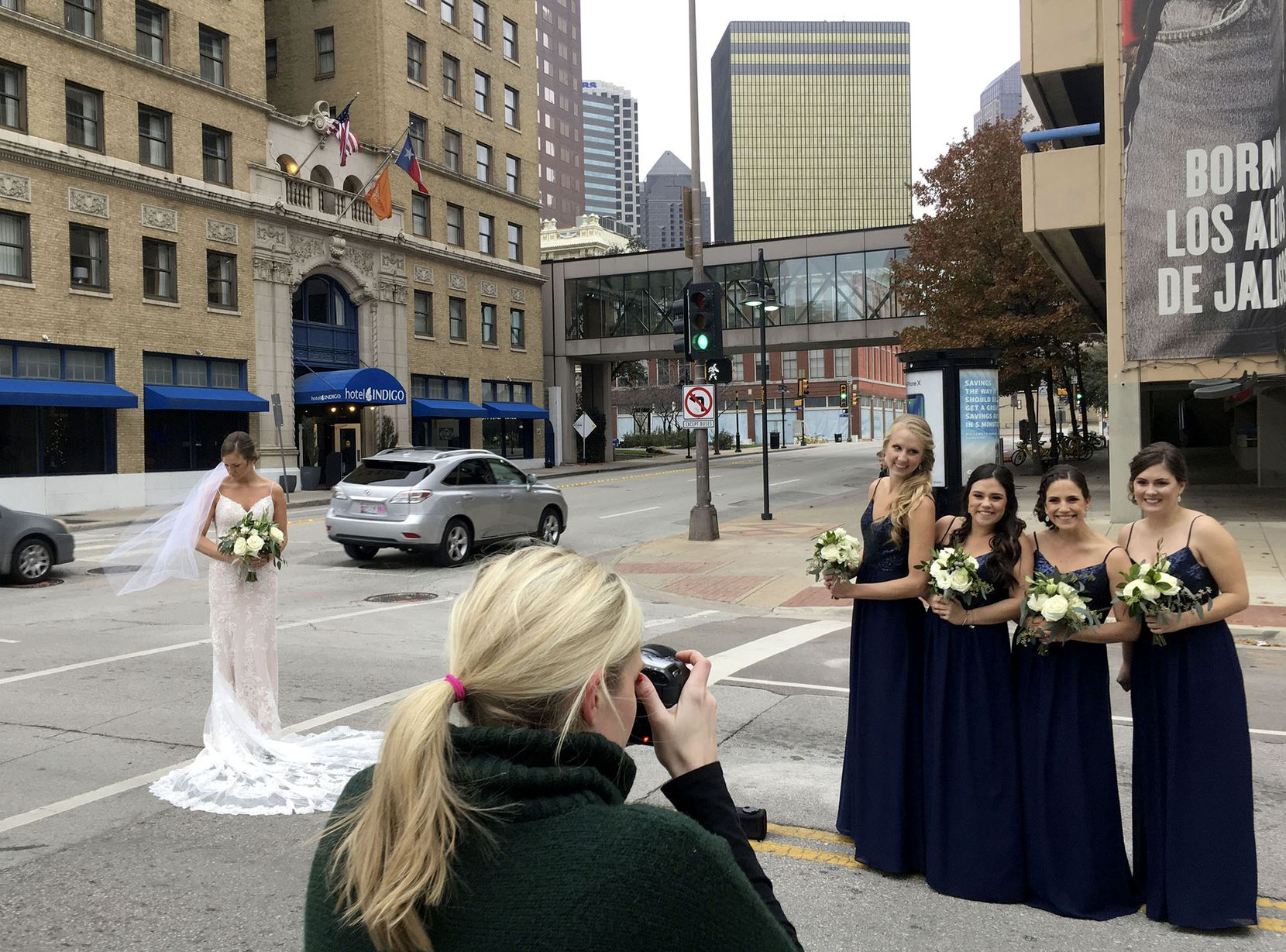 """""""Beauty is pain,"""" quipped bride-to-be Tori Mellinger (left) tongue-in-cheek as she was getting outdoor portraits taken with her bridal party (from left) Lindsey Miller, Jenna Mellinger, Erin Mellinger and Stephanie Plugge. Photographer Elizabeth Evans, of Eliza Kennard Photography, was snapping their photos on a 28-degree afternoon (in a wind chill that felt like 16) before Tori Mellinger's nuptials to Andrew Plugge in downtown Dallas on Sunday."""