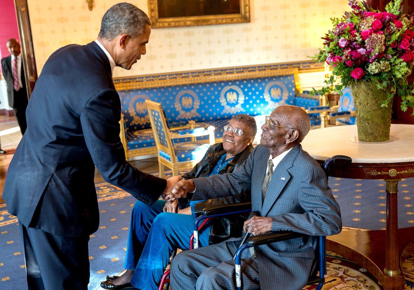 President Barack Obama greets Richard Overton, with Earlene Love-Karo, in the Blue Room of the White House, Nov. 11, 2013. Mr. Overton was attending the Veteran's Day Breakfast at the White House. (Lawrence Jackson/The White House)