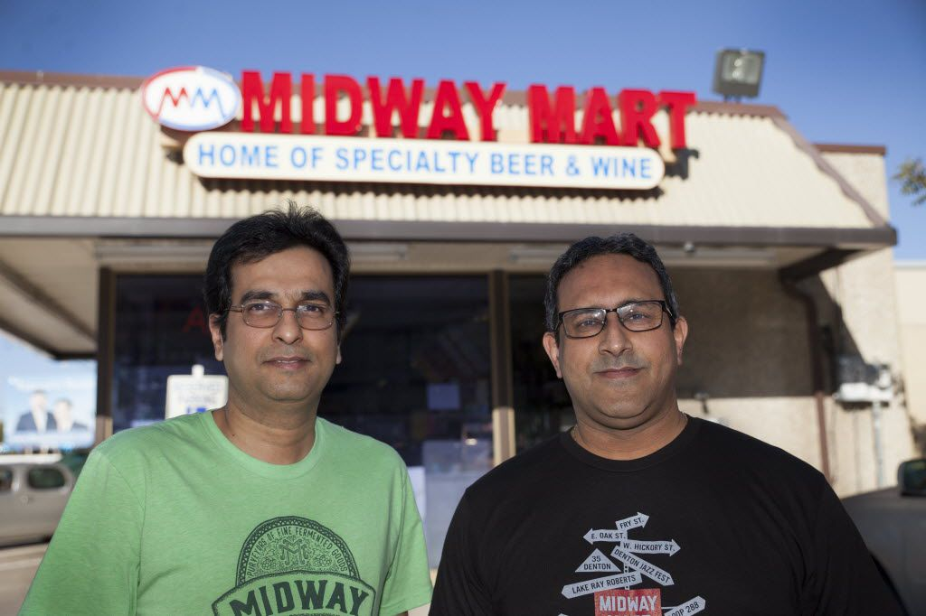 Shaun Tapia, left, and Shakeel Merchant, owners of Midway Mart, pose outside their current store on Thursday, November 19, 2015.