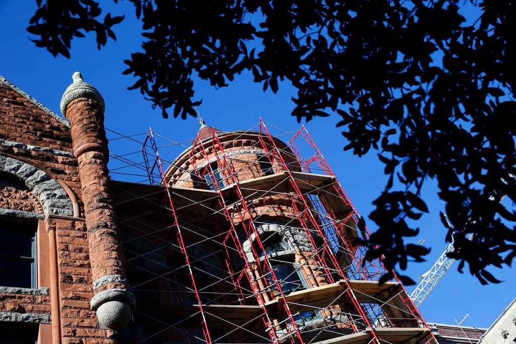 Scaffolding covers the outside of Old Red Courthouse in order to clean the brick and replace the slate roof.  A celebration of James Pratt's life and legacy will be held on Sunday, March 3, from 2 to 4 p.m. at the historic Old Red Courthouse, which Pratt restored and transformed into a museum.