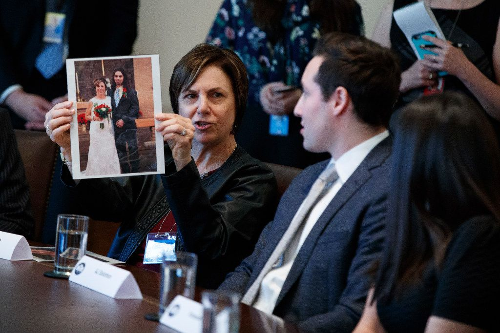 Pam Garozzo held up a photograph of her late son, Carlos, during a listening session with President Donald Trump on opioid and drug abuse March 29.