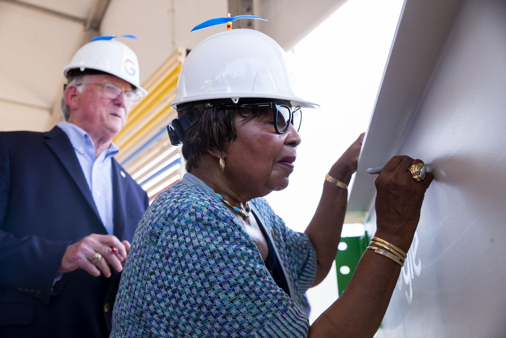 Midlothian mayor Richard Reno and U.S. Representative Eddie Bernice Johnson sign a steel bar during an announcement of Google's new data center in Midlothian on Friday.