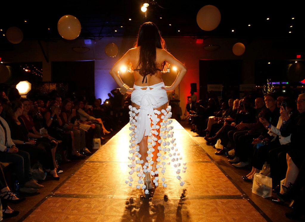 Model Amy Jean Lopez shows off her S'more dessert dress with pearls and marshmallow strings, a chocolate brassiere and graham cracker bracelet designed by Aneesah Perkins under the label Niyah Sani Boutique.