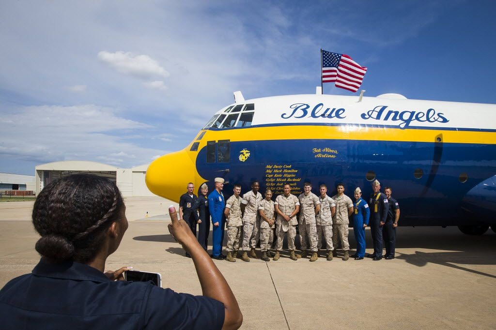 """A group of U.S. Marines who flew on a demonstration flight pose for photos with the crew members of the Blue Angles  C-130T, nicknamed """"Fat Albert,"""" at the Bell Helicopter Fort Worth Alliance Air Show at Alliance Airport on Friday, Sept. 11, 2015, in Fort Worth. (Smiley N. Pool/The Dallas Morning News)"""