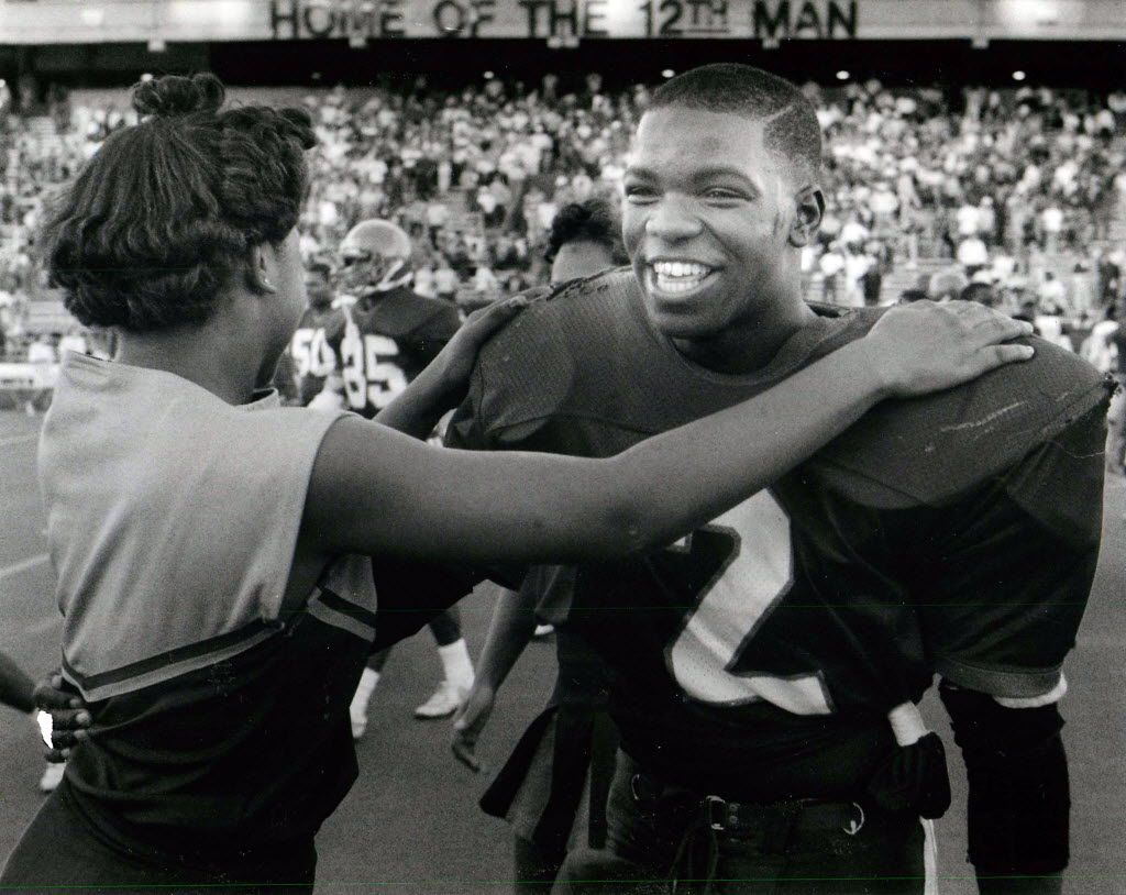 1988: Gary Edwards is congratulated by a cheerleader after a playoff game. Carter won 31-7, with Edwards scoring a touchdown and intercepting a pass.