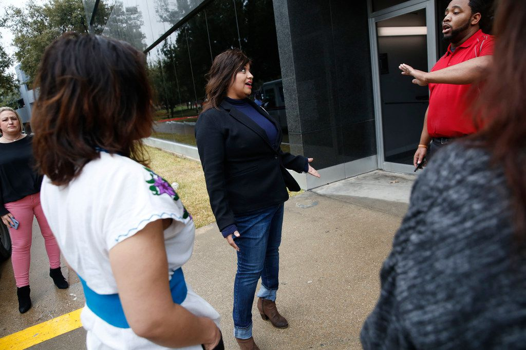 Mandy Watkins of the Beyond Baseball Youth Association is stopped by security on her way to speak to a representative from the Lucious Williams Foundation Wednesday at their office in Dallas.