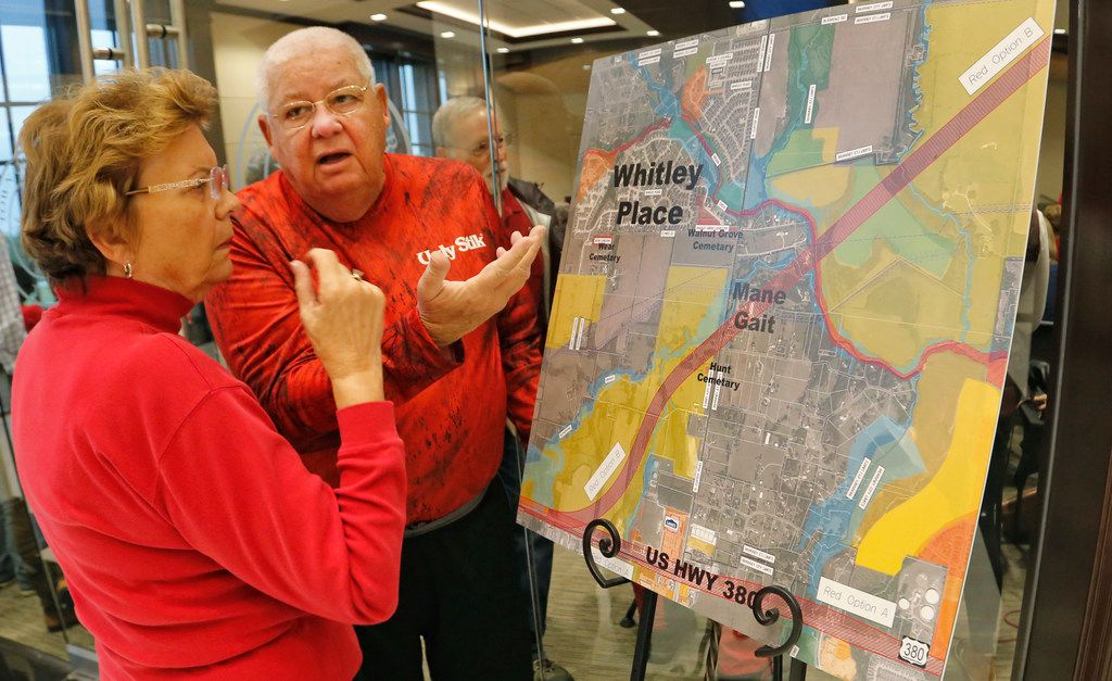 Prosper residents Marcia and Donald Isch talk about the 380 bypass proposal while they look at a map as residents crowd into Prosper Town Hall to oppose an option for a U.S. Highway 380 bypass from the Texas Department of Transportation on Monday, Oct. 15, 2018.