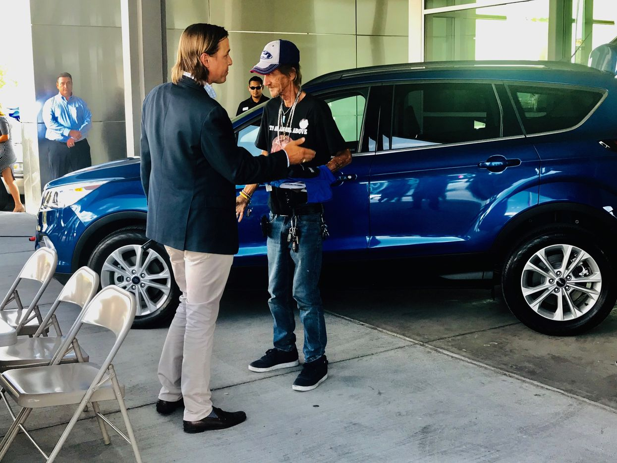 Ronald Wallace Lowenfield of Casa Ford Lincoln Nissan in El Paso presents Antonio Basco with a new Ford Escape to replace the his stolen vehicle on Monday afternoon.