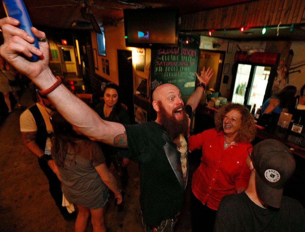 """'Handsome' Shawn screams, """"I'm out of a (explitive deleted) job now,"""" next to owner, Rosie Nagy dafter last call at Elbow Room in Dallas on April 16, 2017. (Nathan Hunsinger/The Dallas Morning News)"""