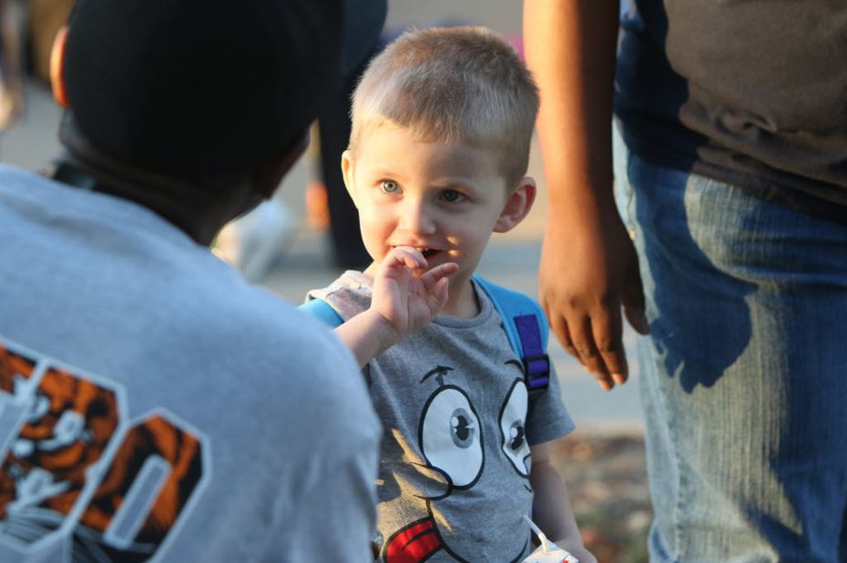 Daniel Anderson, 3, listened intently to Lancaster High School boys varsity basketball  assistant coach Autry Bostick during National Night Out festivities in 2015.
