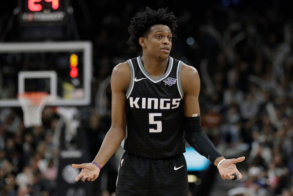 Sacramento Kings guard De'Aaron Fox (5) reacts after a play during the second half of an NBA basketball game against the San Antonio Spurs, Monday, April 9, 2018, in San Antonio. San Antonio won 98-85. (AP Photo/Eric Gay)