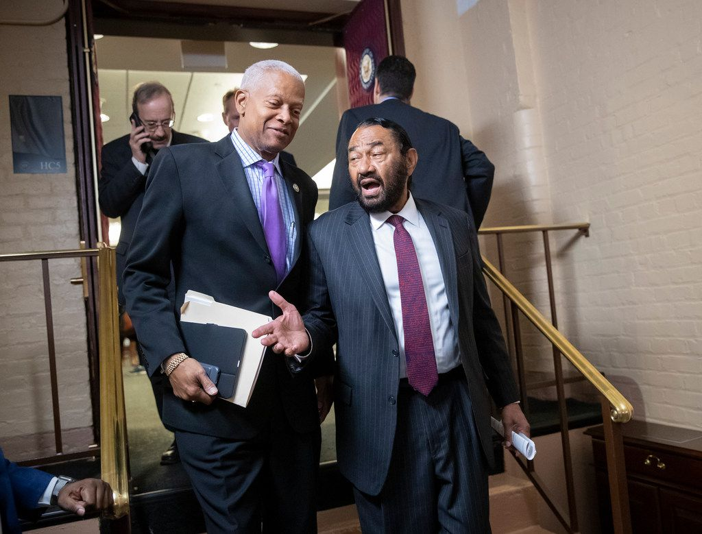 Rep. Hank Johnson, D-Ga. (left), and Rep. Al Green, D-Houston, leave a Democratic Caucus meeting at the Capitol on Nov. 15,  2018. As of Nov. 19, Green had not said whether he supports Nancy Pelosi for speaker.
