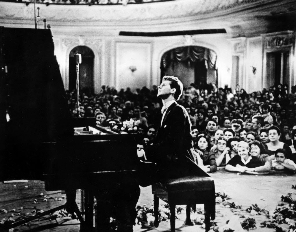In this photo provided by the Van Cliburn Foundation, Texas pianist Van Cliburn performs to a packed audience in the Great Hall of the Moscow Conservatory in Moscow, Russia, in April 1958 during the first International Tchaikovsky Competition, which he won.