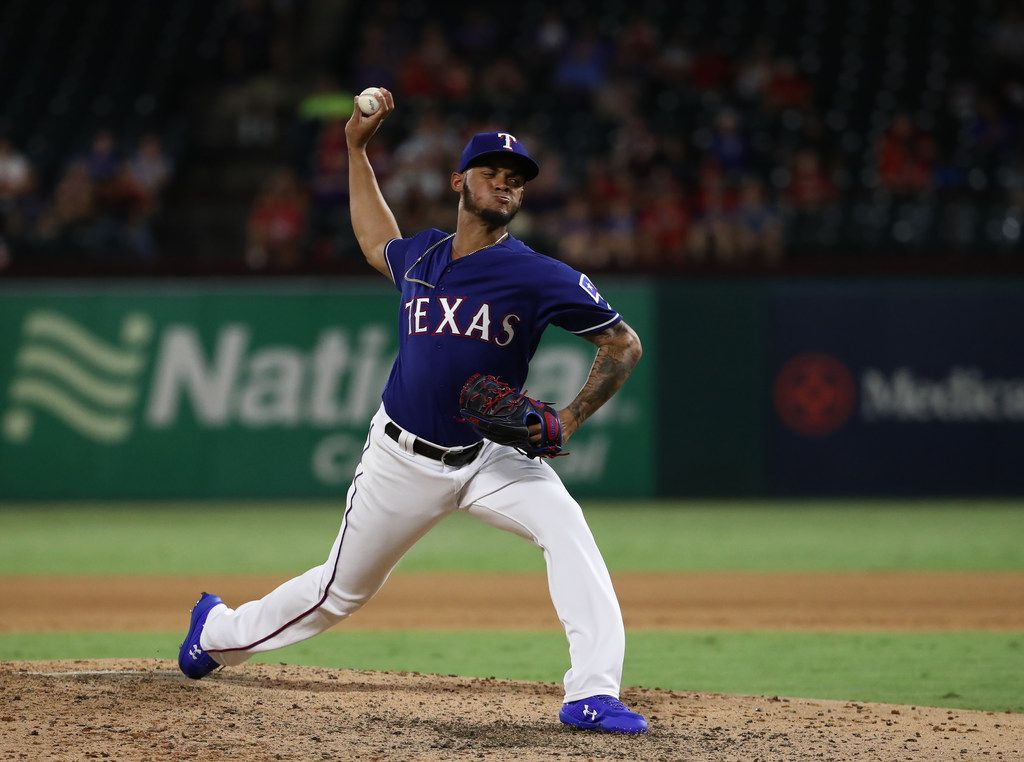 ARLINGTON, TEXAS - AUGUST 21:  Jonathan Hernandez #72 of the Texas Rangers throws against the Los Angeles Angels at Globe Life Park in Arlington on August 21, 2019 in Arlington, Texas. (Photo by Ronald Martinez/Getty Images)