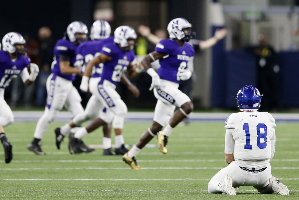 Gunter's Daylan Bower (18) sits dejected as Newton's Tamauzia Brown (8) runs off the field celebrating after intercepting a pass from Bower during the first half of play of the Class 3A Division II state championship at AT&T Stadium in Arlington, Texas on Thursday, December 21, 2017. (Vernon Bryant/The Dallas Morning News)