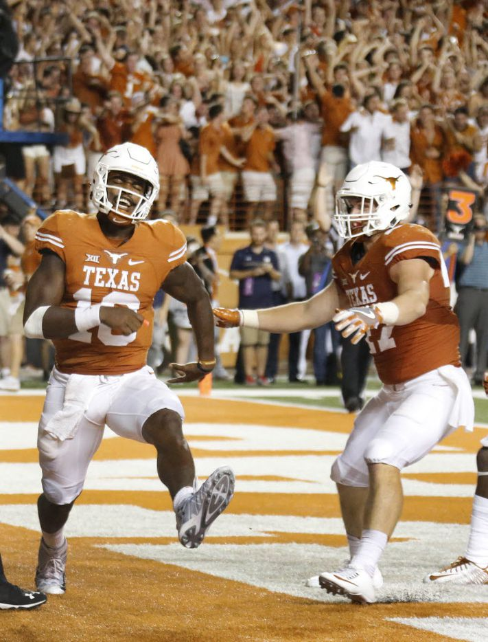 Texas quarterback Tyrone Swoopes (18) celebrates scoring a rushing touchdown in the first overtime during the Notre Dame Fighting Irish vs. the University of Texas Longhorns NCAA football game at Darrell K. Royal Memorial Stadium in Austin on Sunday, September 4, 2016. (Louis DeLuca/The Dallas Morning News)