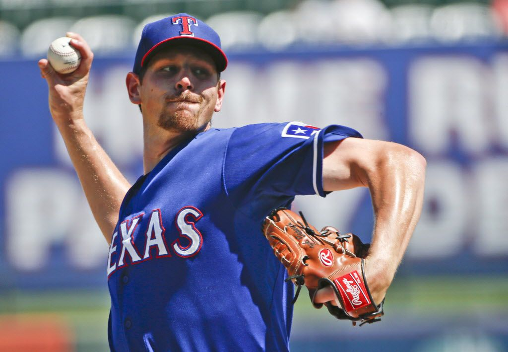 Texas Rangers starting pitcher Nick Tepesch works the first inning against the Los Angeles Angels in a spring training baseball game Tuesday, March 24, 2015, in Surprise, Ariz. (AP Photo/Lenny Ignelzi) 03262015xNEWS