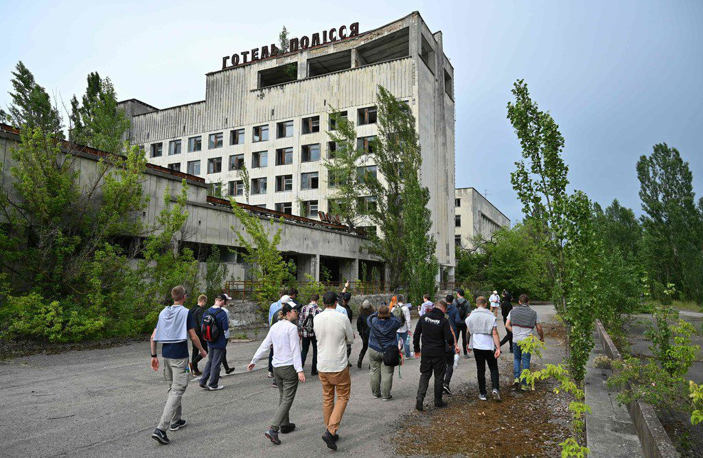 Visitors walk in the ghost city of Pripyat during a tour of the Chernobyl Exclusion Zone. HBO's hugely popular television series Chernobyl has renewed interest in Ukraine's 1986 nuclear disaster.