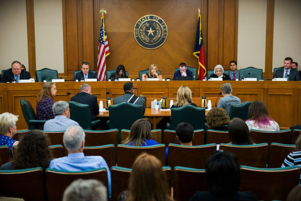 Trenton Johnson, center at the table, and others voice their opinions on the bathroom bill at a Senate State Affairs Committee public hearing on the fourth day of a special legislative session on Friday at the Texas state capitol in Austin, Texas.