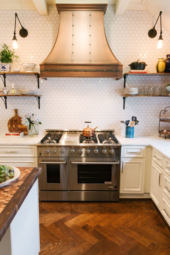 There's no denying the Parisian influence with a custom copper vent hood over a professional gas range, says Tara Lenney.