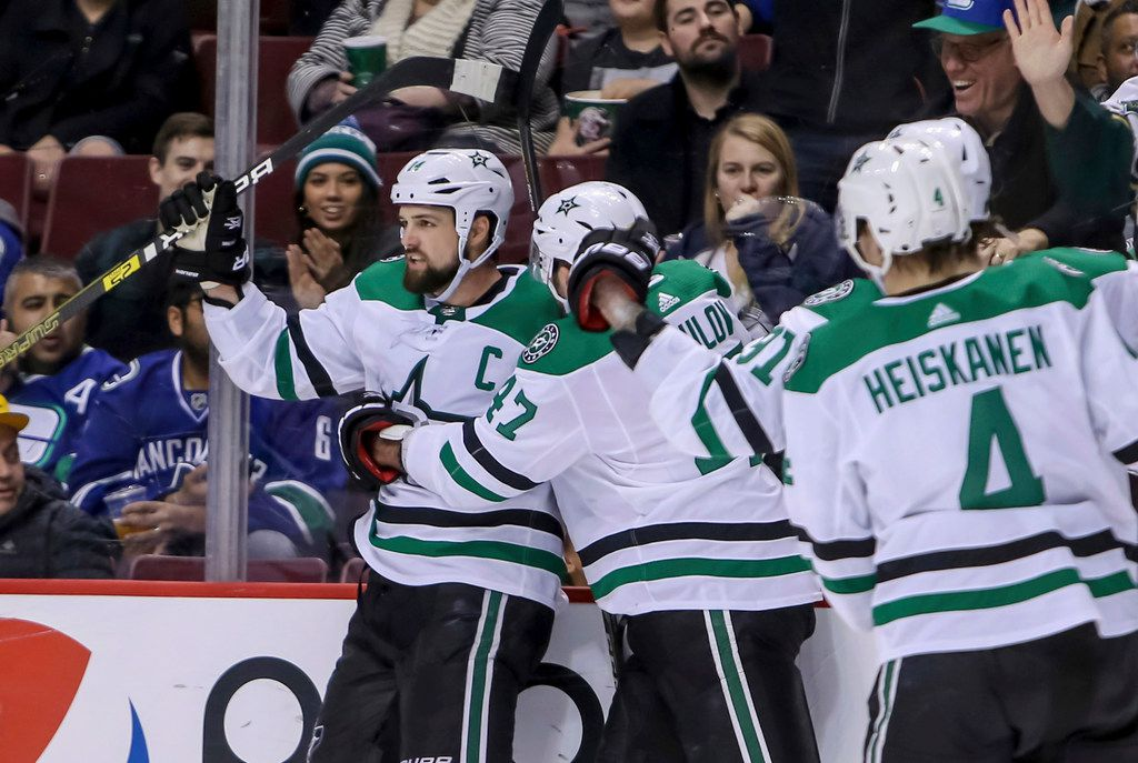 Dallas Stars' Jamie Benn (14) celebrates his goal against the Vancouver Canucks during the third period of an NHL hockey game Saturday, Dec. 1, 2018, in Vancouver, British Columbia. (Ben Nelms/The Canadian Press via AP)