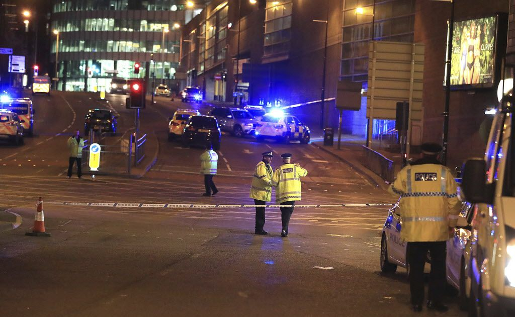 Emergency services work at Manchester Arena after reports of an explosion at the venue during an Ariana Grande gig in Manchester, England Monday, May 22, 2017. Several people have died following reports of an explosion Monday night at an Ariana Grande concert in northern England, police said. A representative said the singer was not injured. (Peter Byrne/PA via AP)