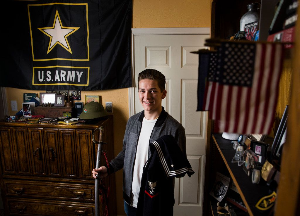 Andy Fancher, 18, holds a Civil War saber that's a family heirloom and a WWII Navy uniform given to him by veteran Louis Beavers. His bedroom in Duncanville is filled with military memorabilia.