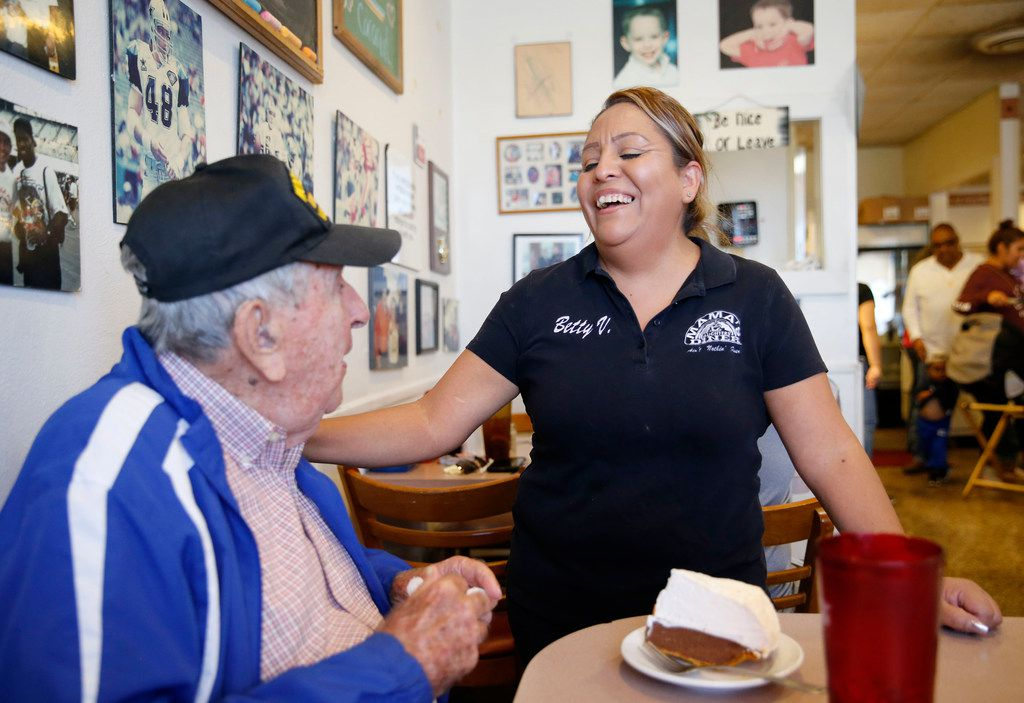 Chester Hollingsworth shares a laugh with Betty Vazquez shortly after the crew sang happy birthday to him at Mama's Daughters' Diner  in Dallas.