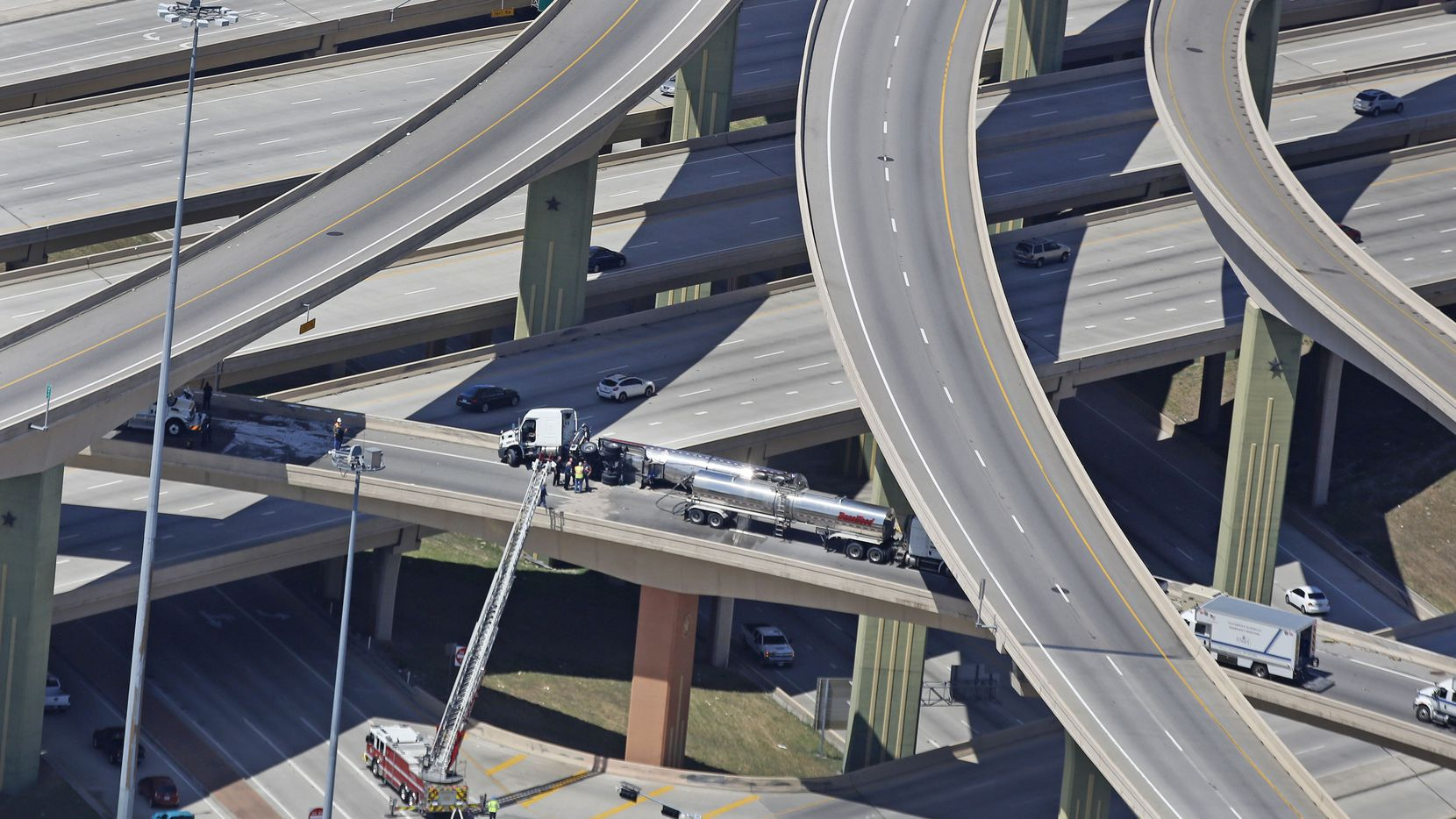 The Intersection of Interstate 635 and Highway 75 north of downtown Dallas closed after an overturned truck carrying hazardous materials crashed Thursday.