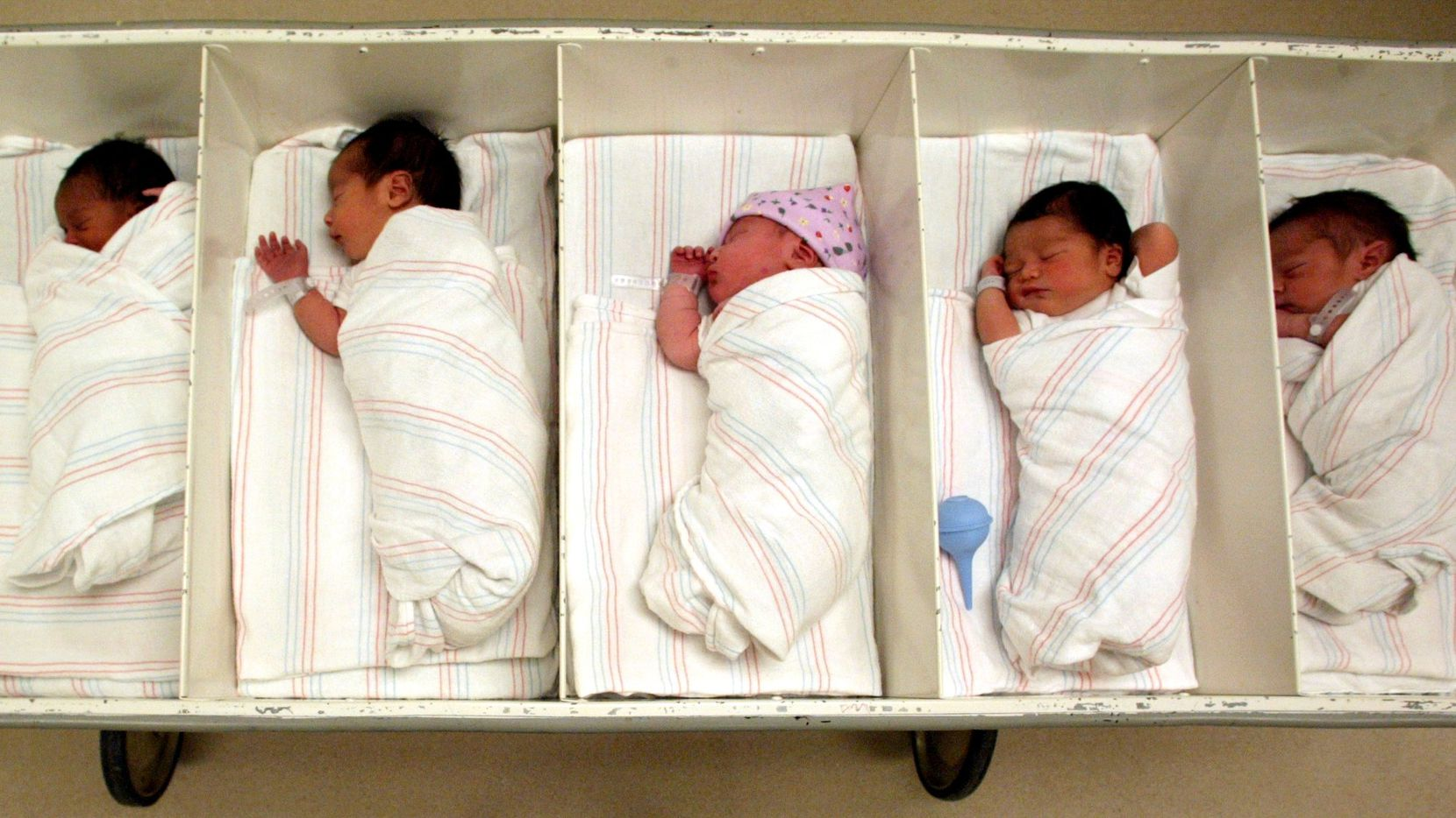 """Parkland Memorial Hospital uses a newborn transporter nicknamed """"six-pack"""" to efficiently cart infants from the newborn nurseries to their mothers.  Photographed on Feb. 24, 2004"""