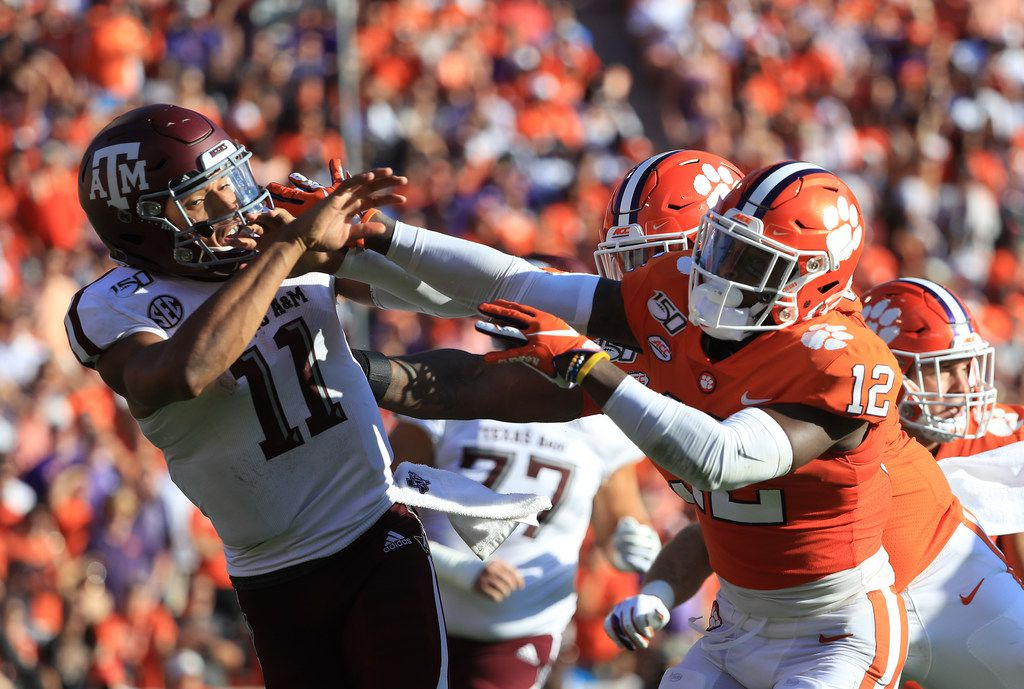 CLEMSON, SOUTH CAROLINA - SEPTEMBER 07: K'Von Wallace #12 of the Clemson Tigers runs into Kellen Mond #11 of the Texas A&M Aggies during their game at Memorial Stadium on September 07, 2019 in Clemson, South Carolina. (Photo by Streeter Lecka/Getty Images)