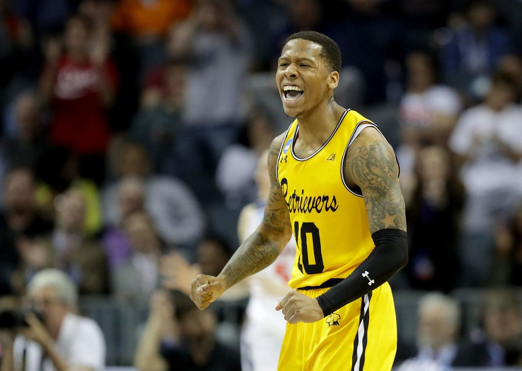 CHARLOTTE, NC - MARCH 16:  Jairus Lyles #10 of the UMBC Retrievers reacts after a score against the Virginia Cavaliers in the second half during the first round of the 2018 NCAA Men's Basketball Tournament at Spectrum Center on March 16, 2018 in Charlotte, North Carolina.  (Photo by Streeter Lecka/Getty Images)
