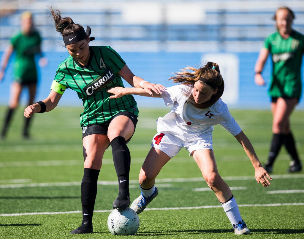 Southlake Carroll forward Taylor Tufts (4) takes the ball from Austin Lake Travis defender Bronwyn Bates (4) during the first half of a UIL conference 6A girls state semifinal soccer game between Southlake Carroll High School and Lake Travis High School on Friday, April 19, 2019 at Birkelbach Field in Georgetown, Texas. (Ashley Landis/The Dallas Morning News)