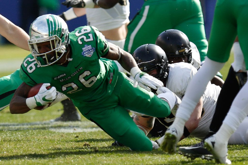 North Texas junior running back Jeffrey Wilson (26) rushes the football against the Army defense at Cotton Bowl Stadium, Tuesday, December 27, 2016, in Dallas, Texas, Jeff Woo/DRC