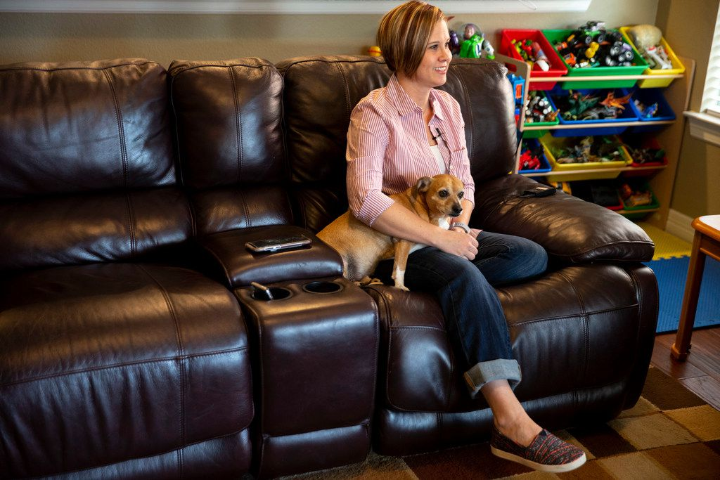 Taylor Siler, the first woman whose donated uterus resulted in childbirth in the United States, holds her dog, Jake, during an interview in her  Wylie home.