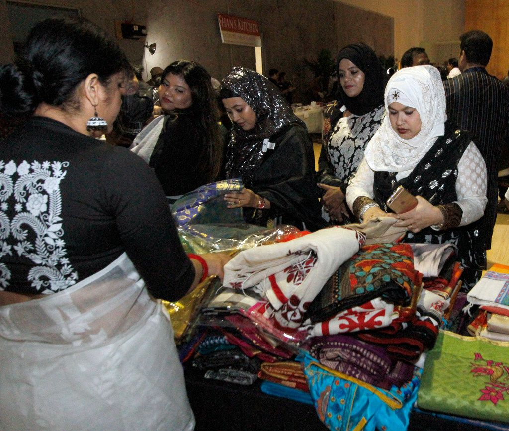 Attendees shop for fabric at  the  International Mother Language Day on Feb. 24 at DFW Family Church in Irving.  The  North Texas Bangladeshi community was celebrating their heritage and their Bangla language.