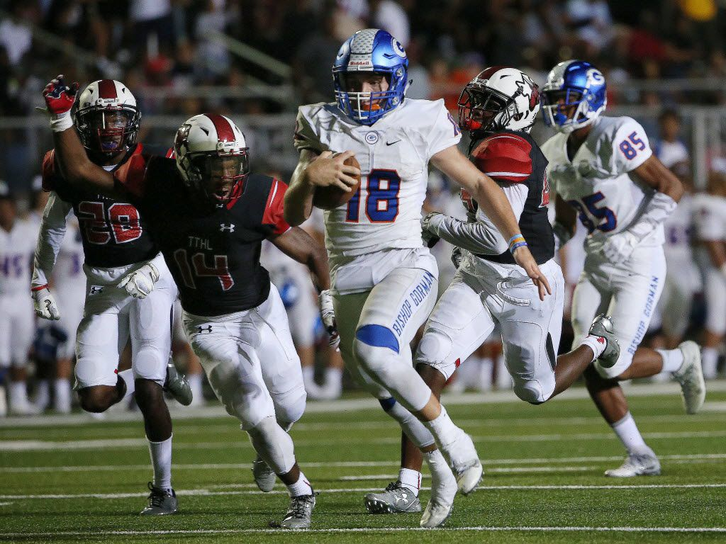 Cedar Hill players are unable to reach Bishop Gorman quarterback Tate Martell (18) as Martell scores a touchdown to make the score 36-14 in the second half during a high school football game between Bishop Gorman, of Las Vegas, Nevada, and Cedar Hill at Longhorn Stadium in Cedar Hill, Texas Saturday August 27, 2016. (Andy Jacobsohn/The Dallas Morning News)
