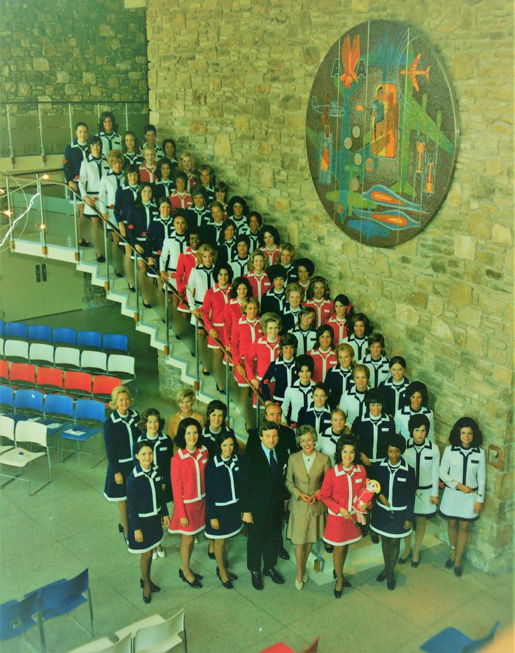 American Airlines flight attendants graduating in 1972 pose for a photo on the staircase at the Stewardess College.