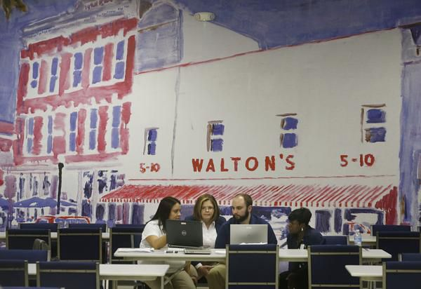 """A painting depicting Wal-Mart founder Sam Walton's first five-and-time store adorns a wall at the company's new """"Talent Center"""" in Irving. Wal-Mart is taking hiring and training out of stores and consolidating those functions at the new center."""