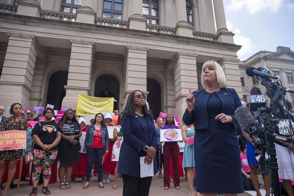 Staci Fox, CEO and President of Planned Parenthood Southeast, speaks during an anti-abortion rally outside of the Georgia State Capitol building following the signing of HB 481 in Atlanta, Tuesday, May 7, 2019. Georgia Governor Brian Kemp signed  legislation on Tuesday banning abortions once a fetal heartbeat can be detected. (Alyssa Pointer/Atlanta Journal-Constitution)