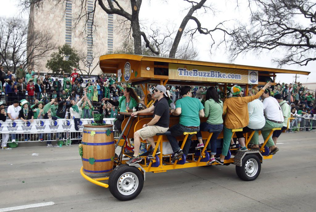 The buzz bike makes its way down the street during the 35th Anniversary Dallas St. Patrick's Parade and Festival on Greenville Avenue in Dallas, on Saturday, March 15, 2014.