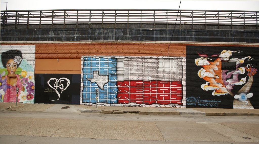 Painted murals from right, Joseph Alexander's 'Fairy's Treasure'; Daniel Yanez's 'Deep Texas Pride'; and Sanah Brown's  'Mega Zee' (left) are seen on a Deep Ellum wall, Tuesday, January 26, 2016. The developers at 42realestate.com have commissioned 42 local artists to create painted murals. (Tom Fox/The Dallas Morning News)