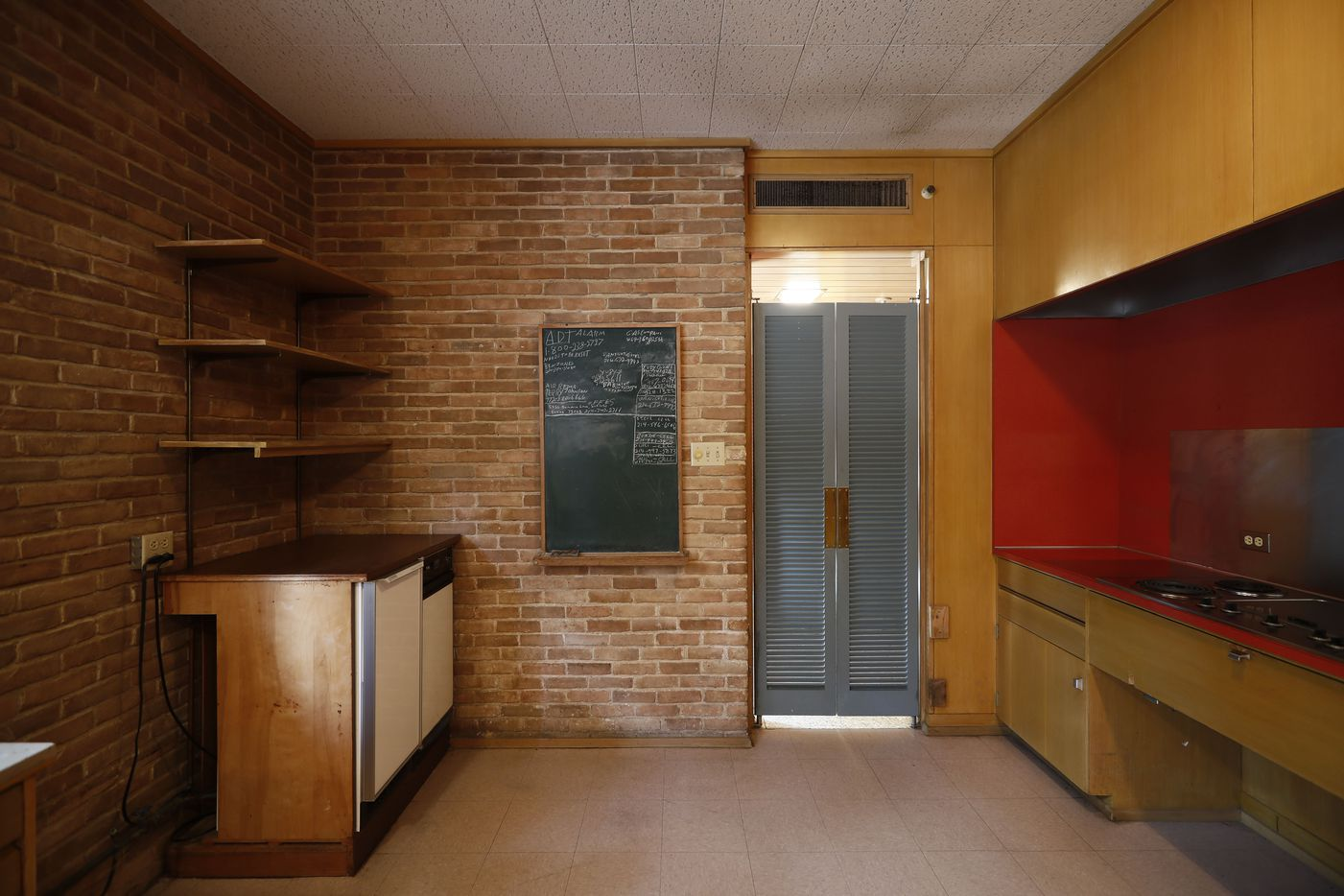 The exposed Mexican brick is integral to the house, even in the kitchen.