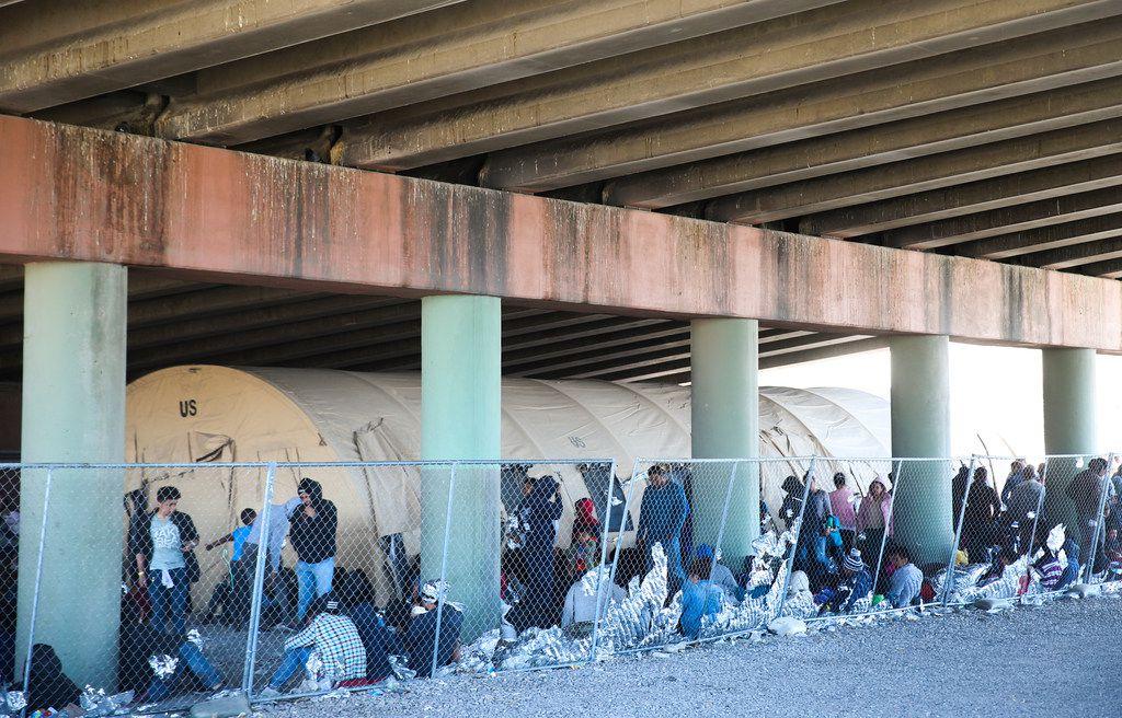 Migrants seeking asylum are held in a temporary transition shelter under the Paso Del Norte bridge in El Paso, Texas, on March 28, 2019.