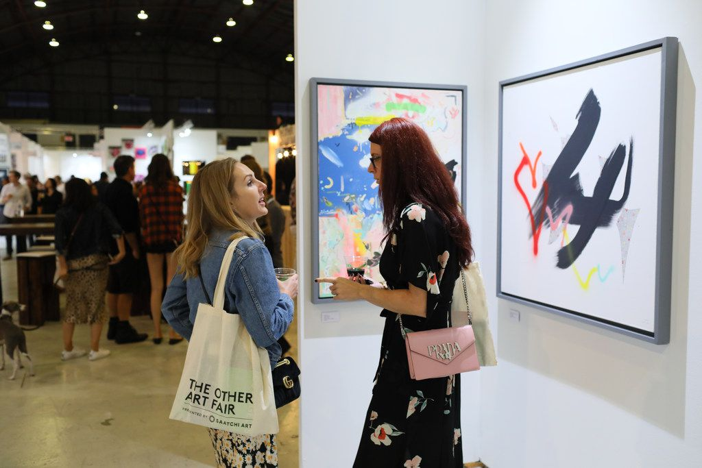 Artists' booths took over the Barker Hangar on Oct. 27, 2018 in Santa Monica, Calif. as part of the Other Art Fair Los Angeles.