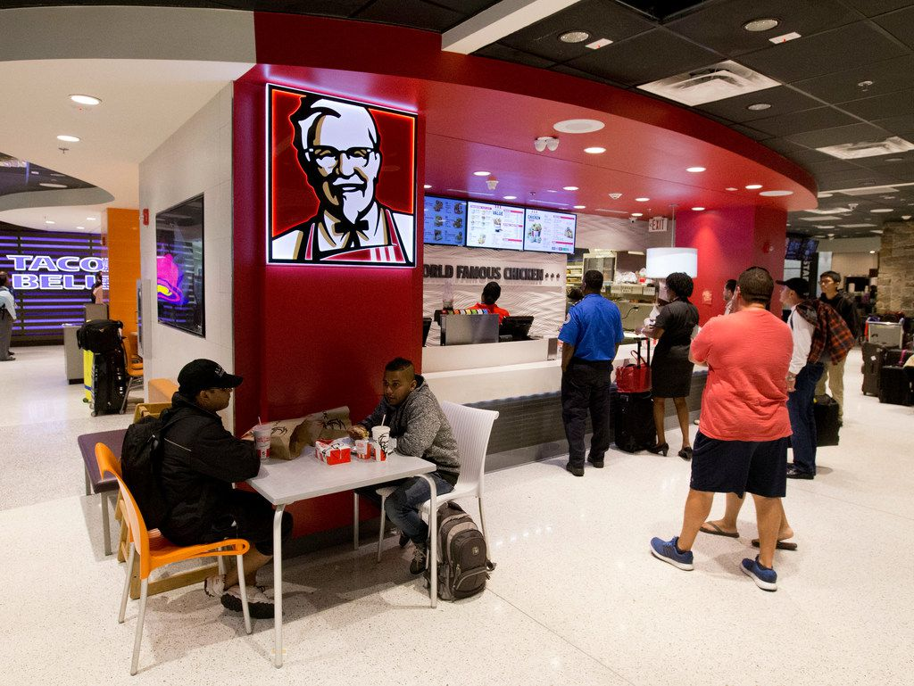 Customers lined up at a Kentucky Fried Chicken restaurant inside Miami International Airport in Miami in 2016. The company's shareholders helped persuade it to switch to antibiotic-free chicken.