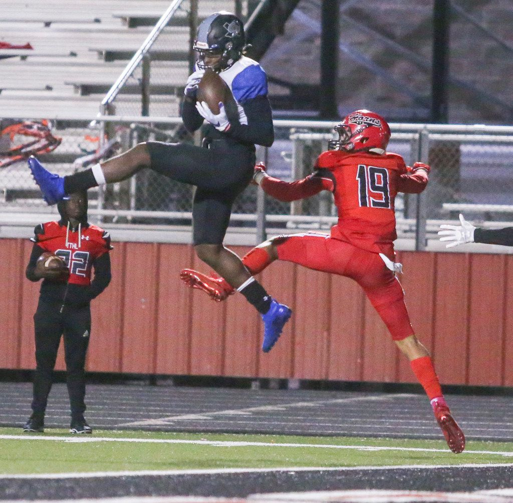 Mansfield Summit wide receiver Jaelon Travis (3) makes a touchdown pass as he is defended by Cedar HIll corner back Jalon Peoples (19) during the first half of a high school football game between Cedar HIll and Mansfield Summit on Friday, October 11, 2019 at Longhorn Stadium in Cedar Hill, Texas. (Shaban Athuman/Staff Photographer)