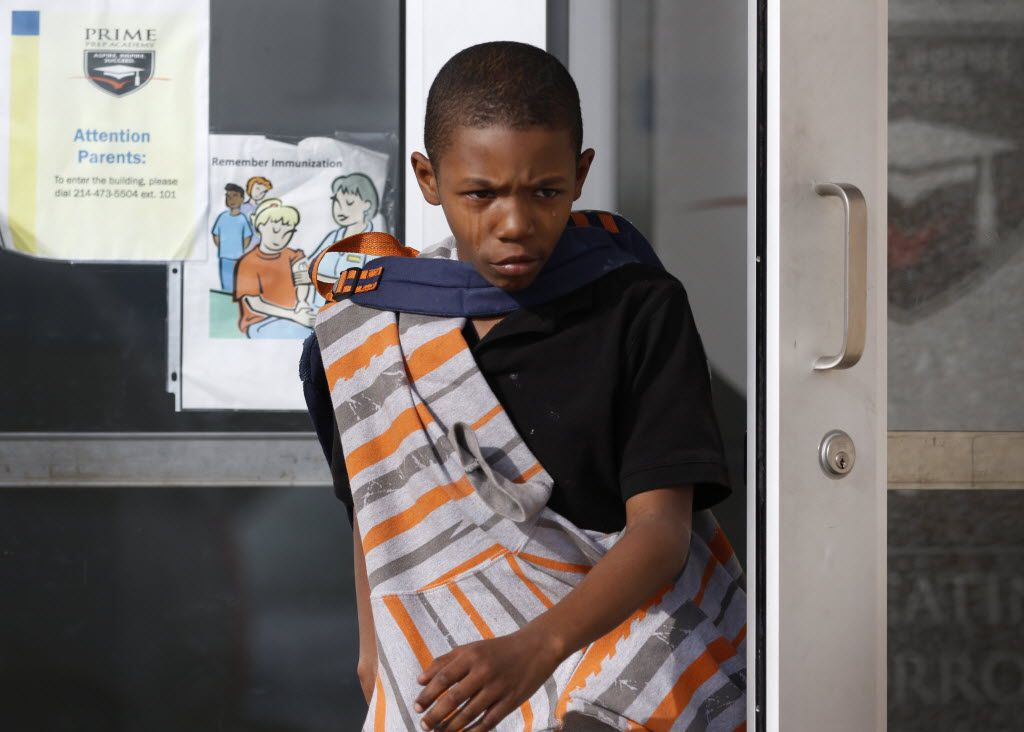 Demarquis Brooks, 10, a fifth grader, sheds tears as he leaves Prime Prep Academy for the last time in Fort Worth on Jan. 30, 2015. A state-appointed board of managers closed the school, which was co-founded by former Dallas Cowboys star Deion Sanders. The school was financially insolvent. (Rose Baca/The Dallas Morning News)