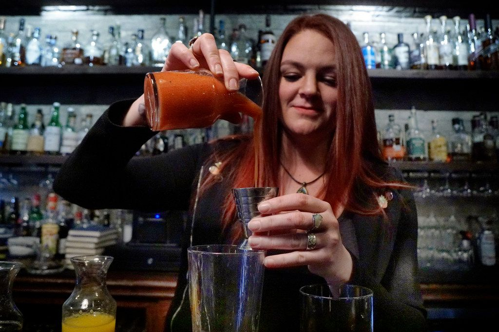 Thompson's Bookstore Beverage Director Brittany Day makes a mocktail at the bar in Fort Worth, Texas on Tuesday January 22, 2019.  (Lawrence Jenkins/Special Contributor)